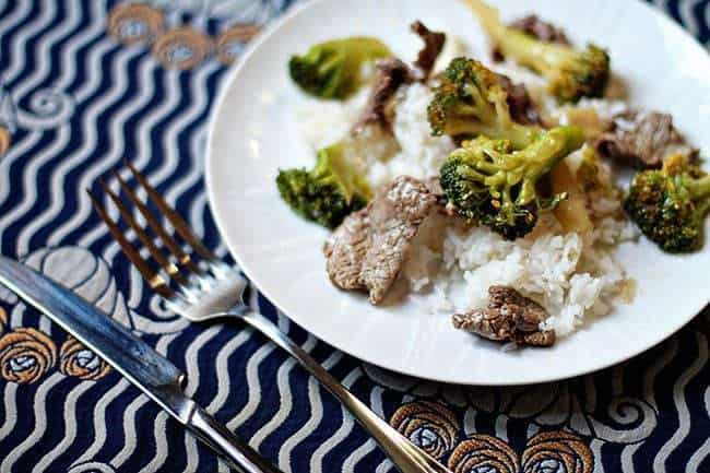 Beef and Broccoli on top of rice in a plate