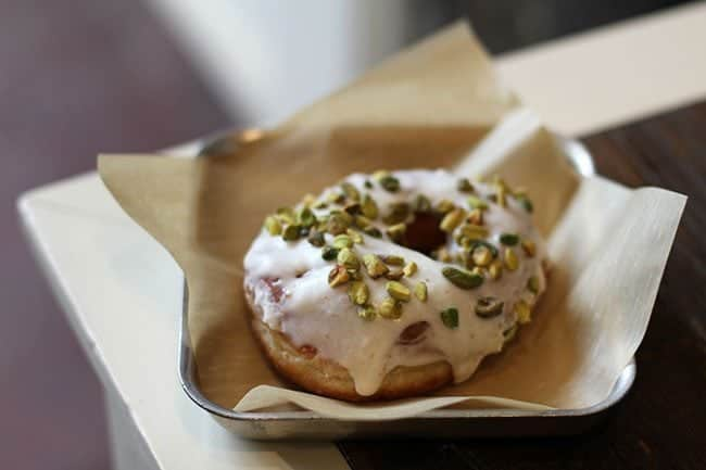 Brown Butter Pistachio Donut with brown sugar glaze and toasted pistachios on top