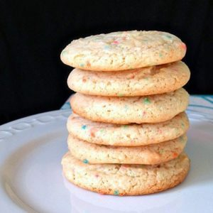 Close up stack of Rainbow Bit Cake Mix Cookies in a White Plate