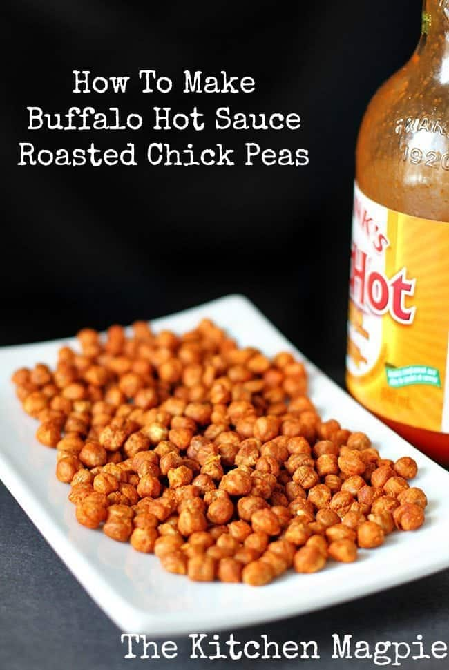 Roasted Chickpeas in a white rectangular plate and a bottle of Buffalo Hot Sauce