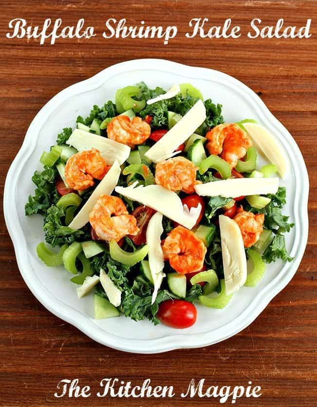 Fantastic buffalo hot sauce shrimp top this healthy kale salad. This is a salad you are happy to eat! #salad #kale #buffalosauce #shrimp
