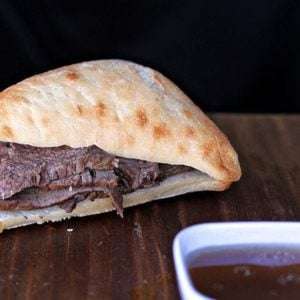 Beef Sandwich and Dip Sauce on Wood Background