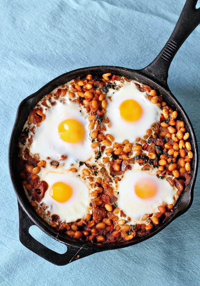 Curried White Bean & Kale Skillet with Four Eggs