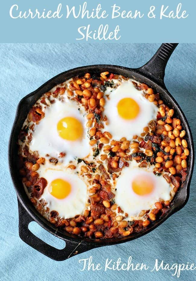 Curried white beans and kale baked into a skillet then topped with eggs? Yes please! Hello decadent breakfast or brunch! #kale #beans #eggs #curry