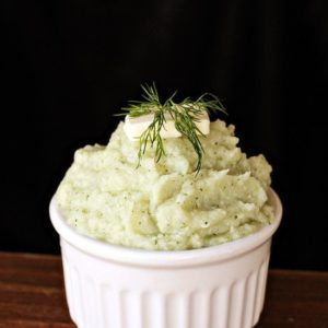 Close up Butter & Dill Mashed Cauliflower in a white ramekins