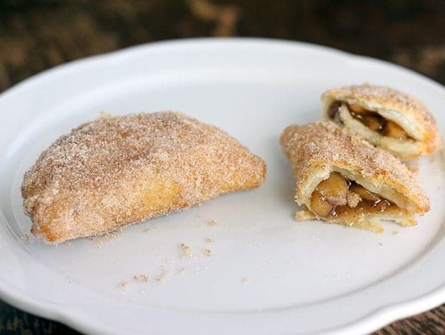 hand held apple pies in a white plate