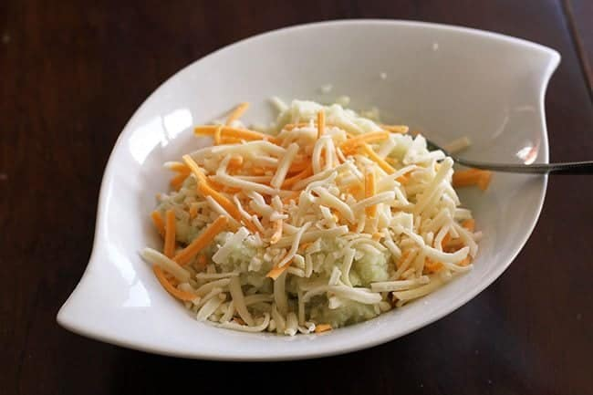 Creamy Mozza, Creamy Herb & Garlic and Creamy Mexicana shredded cheese in a white bowl