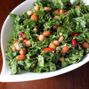 Kale & Mixed Bean Salad with homemade vinaigrette in a white leaf shaped bowl