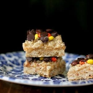 Oatmeal Dream Bars with creamy peanut butter filling in a blue plate