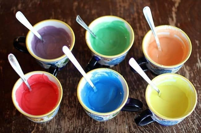 6 cups with colored cake batter for Rainbow Cake Trifle