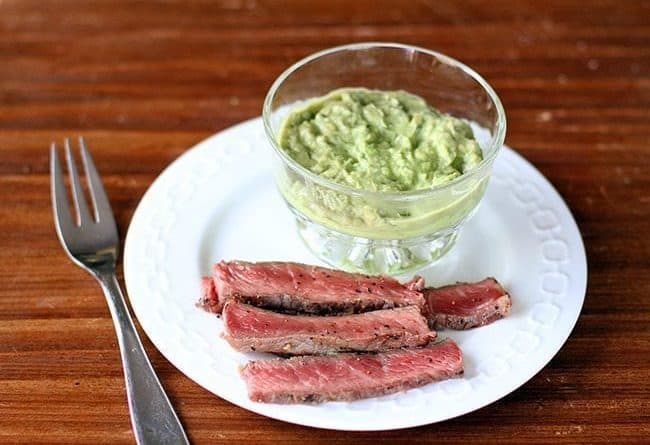 BBQ Steak & Horseradish Guacamole in a white plate with fork on the side