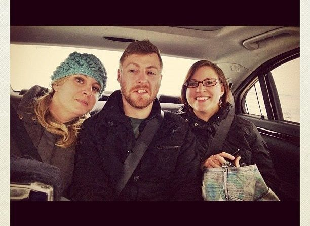 three siblings sitting at the back of the car