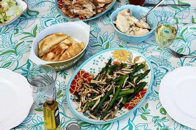Roasted chicken, beer, perogies and cottage cheese crud filled crepes with dill in the table along with roasted asparagus and beech mushrooms