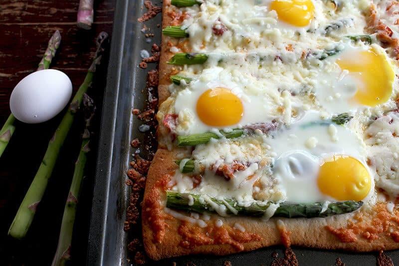 Asparagus, Capicollo & Egg Breakfast Pizza in a baking sheet