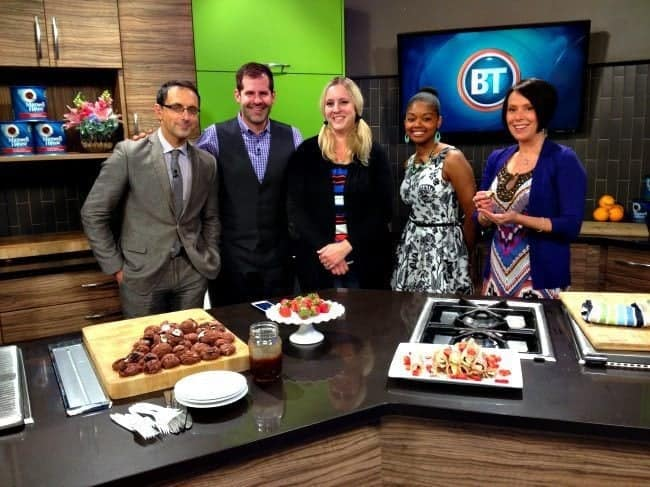 group picture in the kitchen with the staff of Breakfast Television