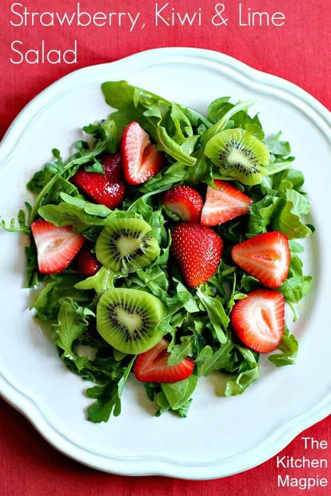 Kiwi, strawberries, spinach and arugula combine to make a sweet, peppery salad with a gorgeous lime dressing. #strawberry #lime #kiwi #salad