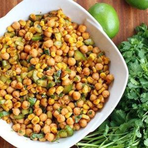 Close up Roasted Corn & Chickpea Salad on a white square bowl