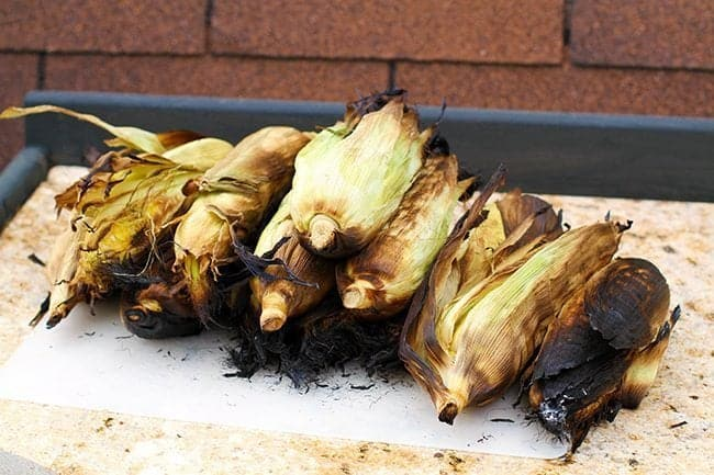 File of Roasted Corn on the Cob With Husks