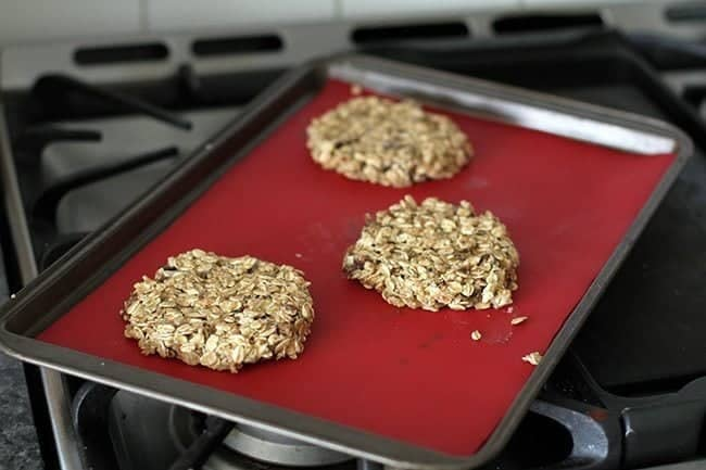 Breakfast Cookies dough pressed down thinly on a parchment lined baking sheet