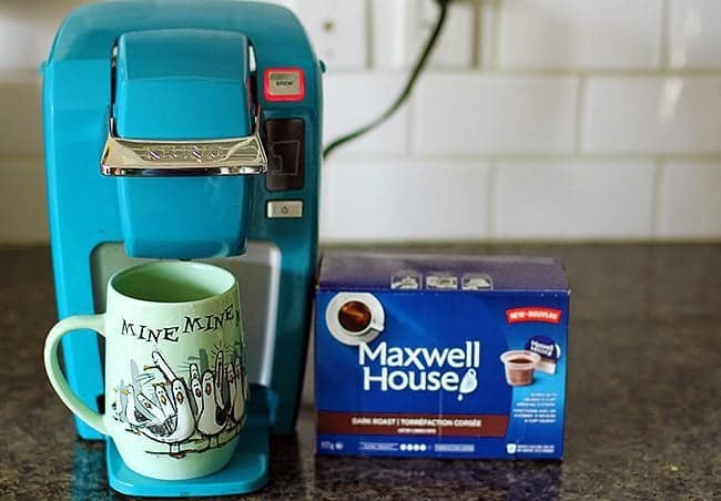 Kraft Keurig Compatible Pods with Mint Green Mug and a box of Maxwell House Coffee