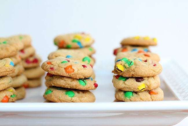 Stacks of colorful Mini Cookies in a white tray