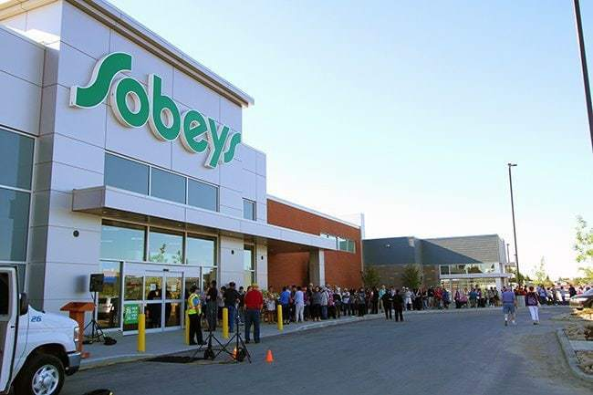 Sobeys building with lots of people waiting to enter
