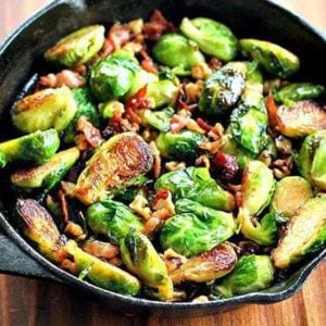 Large frying pan with bacon, walnuts and honey brussels sprouts with melted honey