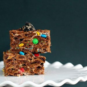 close up Chocolate Oreo & M&M Cereal Bars on a white cake holder