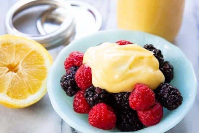 Lemon curd on top of raspberries and blackberries