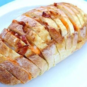 close up of Bacon & Cheese Pull Apart Loaf in a white plate