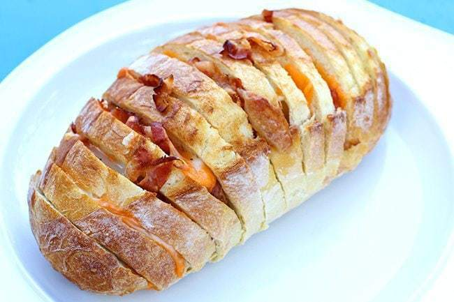 sliced Bacon and Cheese Pull Apart Loaf in a white plate