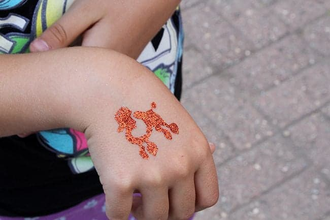Glitter tattoos on kid's hand