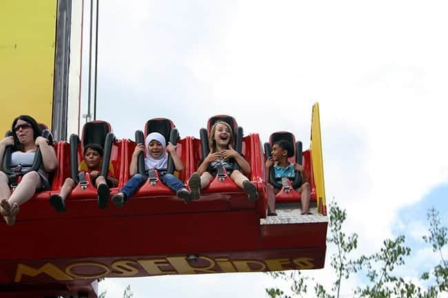 children at the free fallin' ride with faces of joy