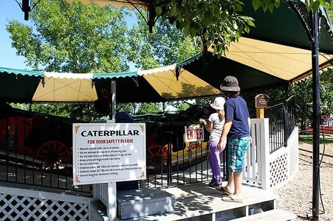 two kids entering the caterpillar ride