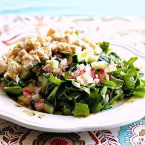 Chicken, Radish and Cucumber Swiss Chard Chopped Salad in a White Plate