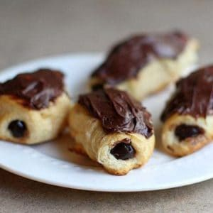baked eclairs with chocolate pudding in the center and topped with chocolate icing