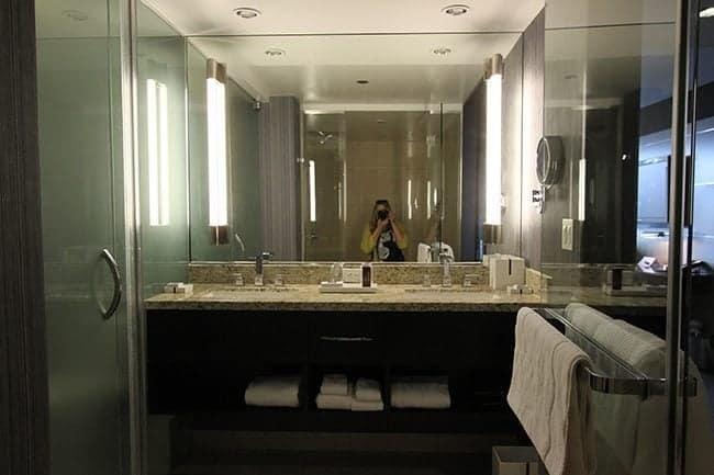 woman taking selfie in front of bathroom mirror