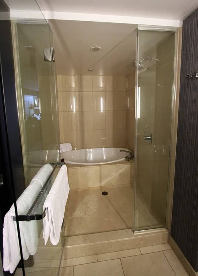 the shower tub combo in the large bathroom