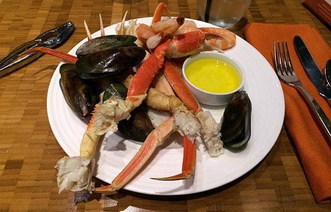 Aria buffet - seafood feast with crab legs and mussels in white plate