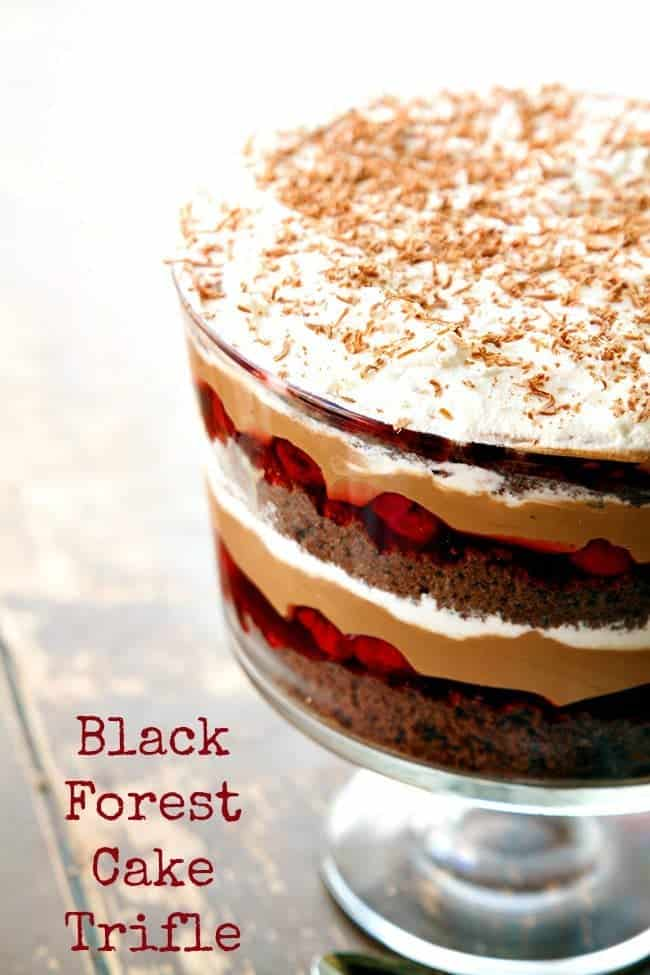 A decadent black forest cake trifle with a homemade chocolate mousse layer, cherries and whipped cream.Perfect for a large dinner! #blackforest #cherry #chocolate #trifle