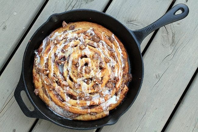 top down shot of Two Ingredient Giant Turtles Cinnamon Bun in skillet on wood background