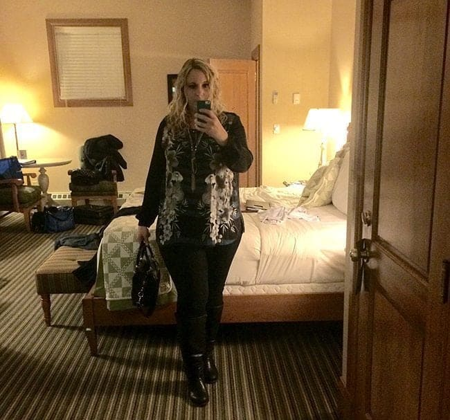 a selfie picture of a woman inside her room