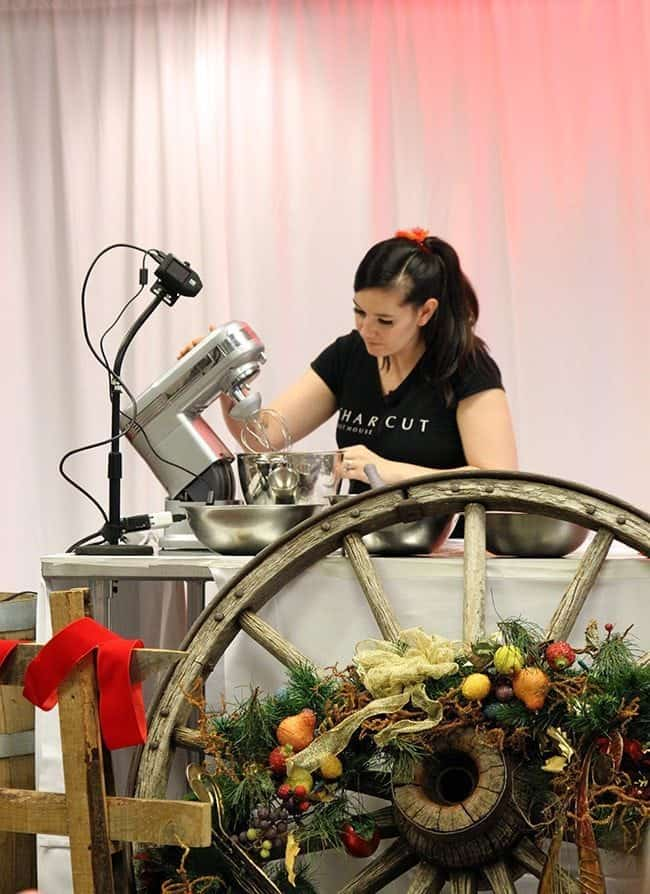 lady wearing black shirt , using the mixer in the presenter table
