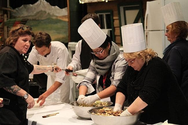 group of chef doing their things in the presentation table