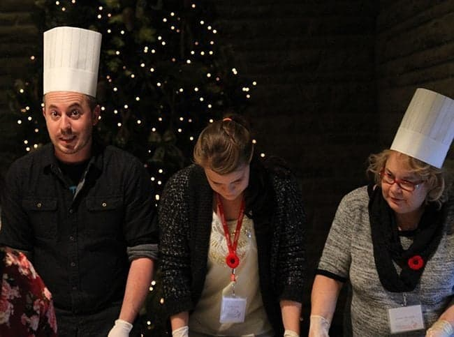 chef helping other presenter in the presentation