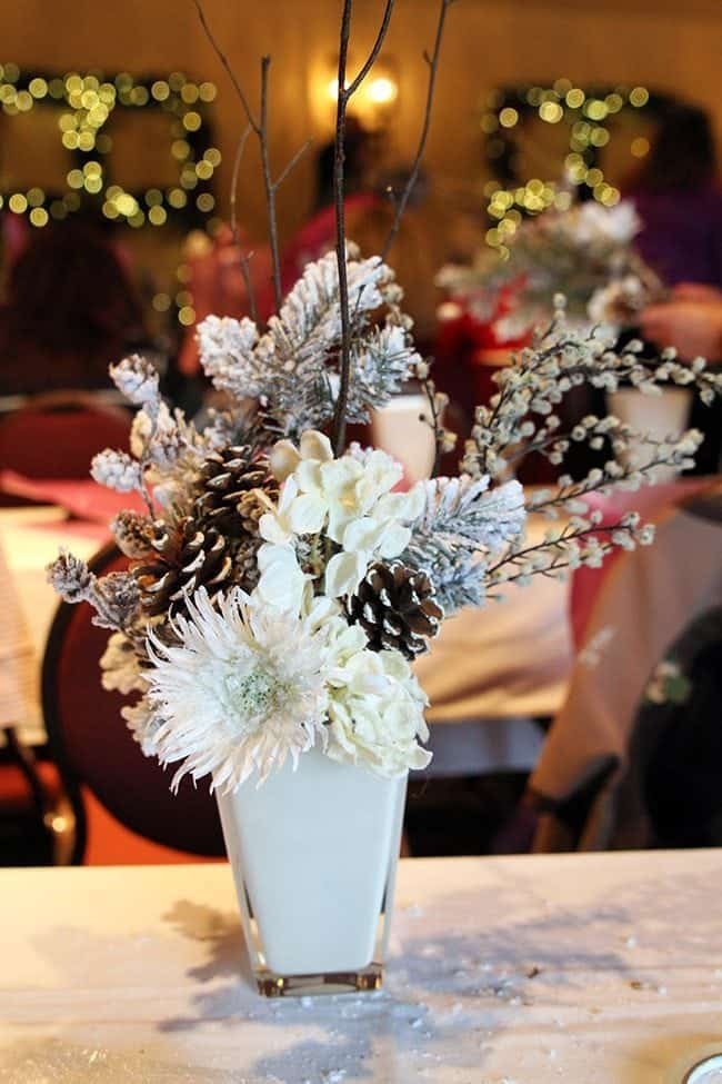 Christmas craft arrangement with white flower in a vase