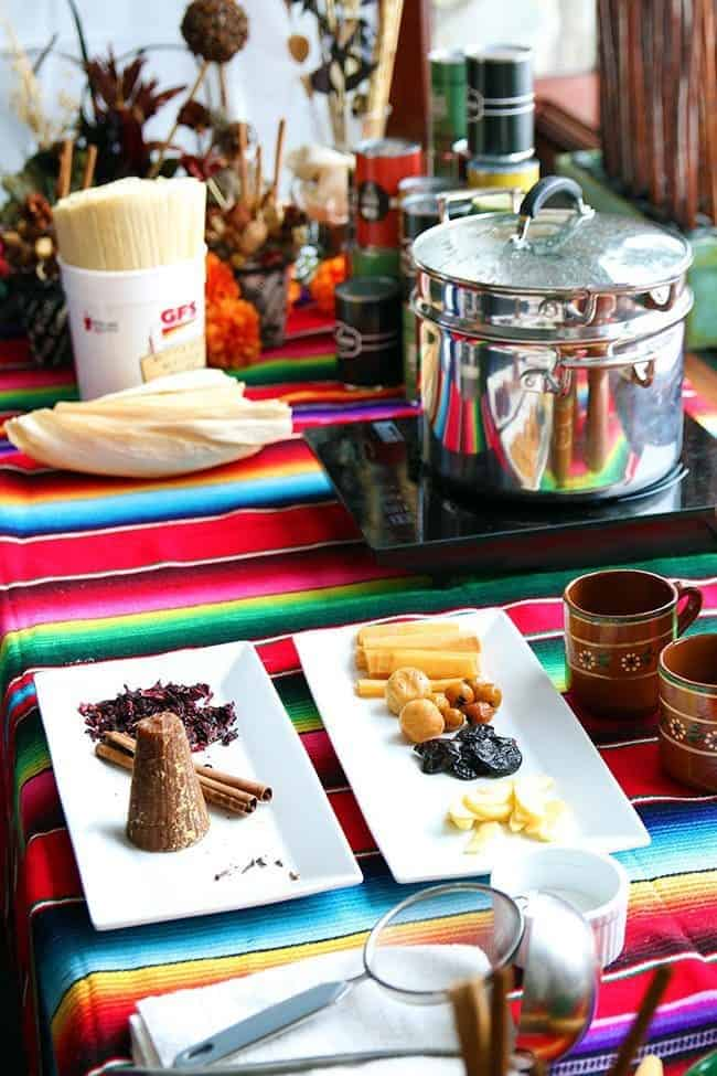 spices, dried fruits and Mexican punch in a Colorful tablecloth