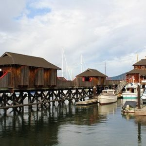 long dock with wooden buildings