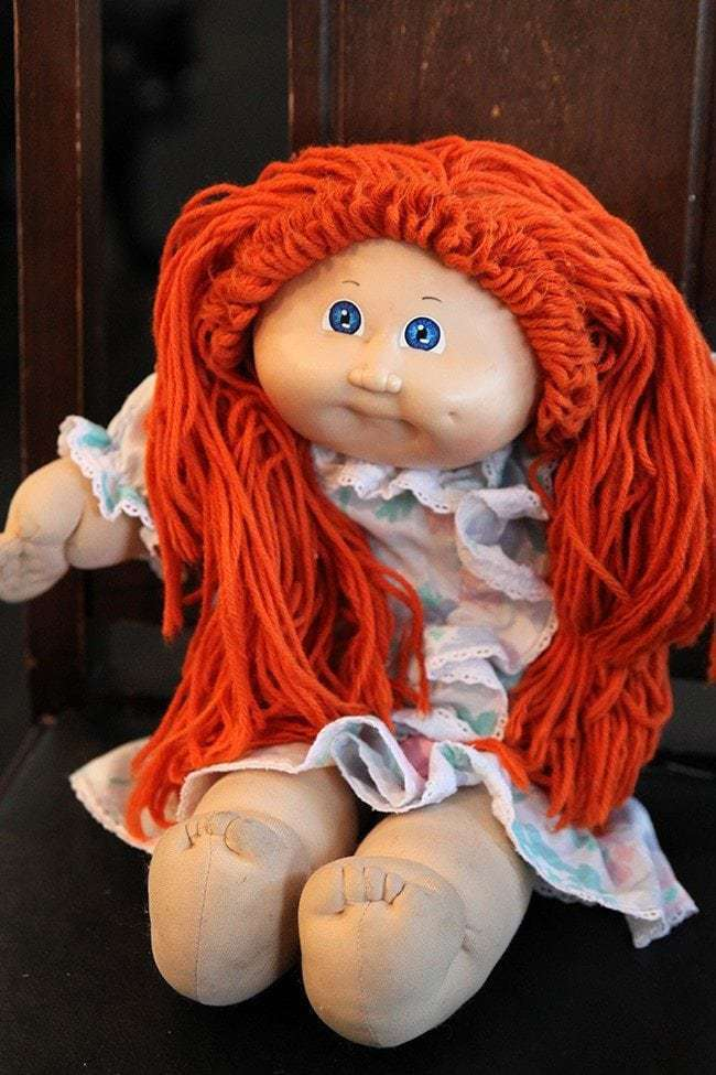 Sitting Cabbage Patch Doll with Orange Hair and Blue eyes