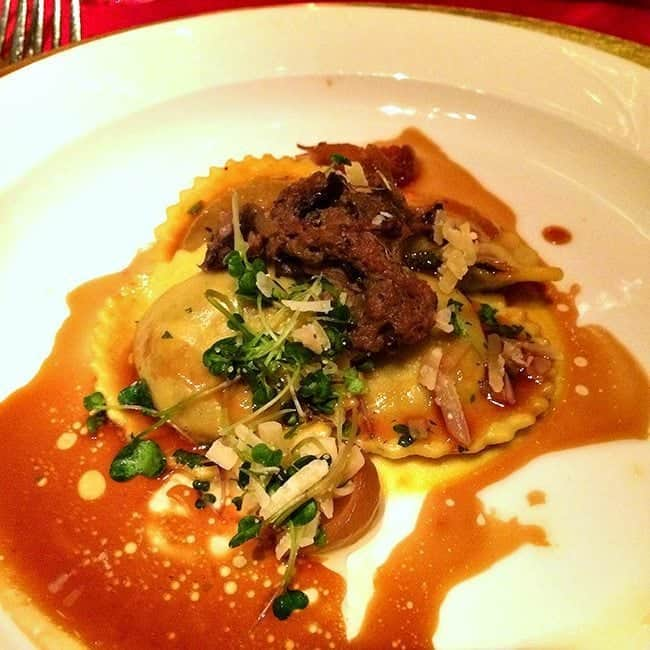 ravioli with braised beef short rib, wild mushroom ragout and Sylvan Star Gouda in a White Plate